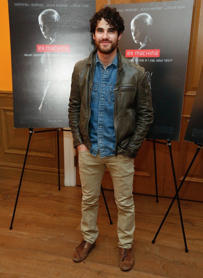Attending the New York premiere of Ex Machina, Darren Criss goes for a classic denim and khaki pairing, finished with a brown leather jacket.