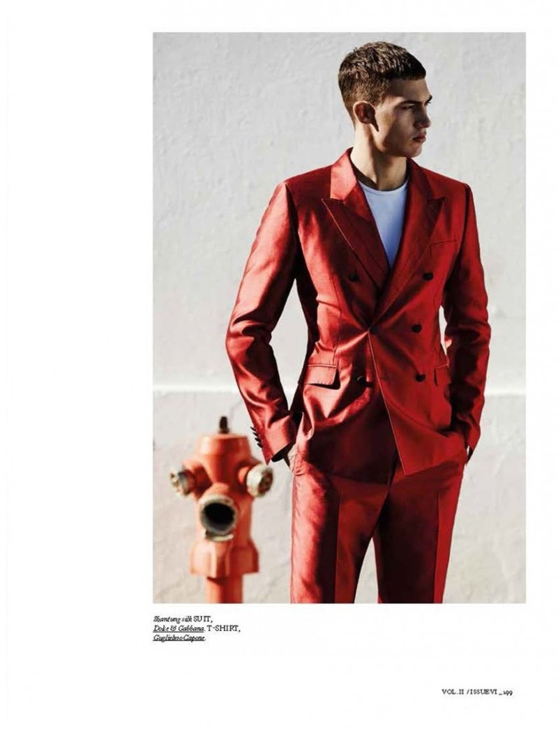 Alessio Pozzi dons a red Dolce & Gabbana suit.