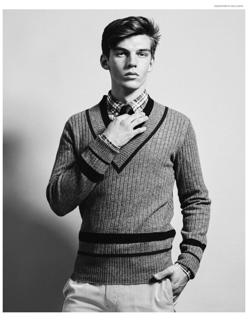 Wearing a v-neck sweater with a shirt and tie, Miles Hurley is the preppy boy next door.