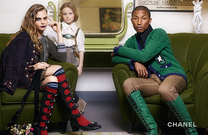 Joined by Cara Delevingne and Hudson Kroenig, Pharrell goes bold in green knee-length boots and a cardigan.