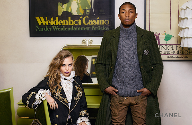 Joining Cara Delevingne, Pharrell cleans up in a cable-knit sweater with coat for a Chanel campaign.