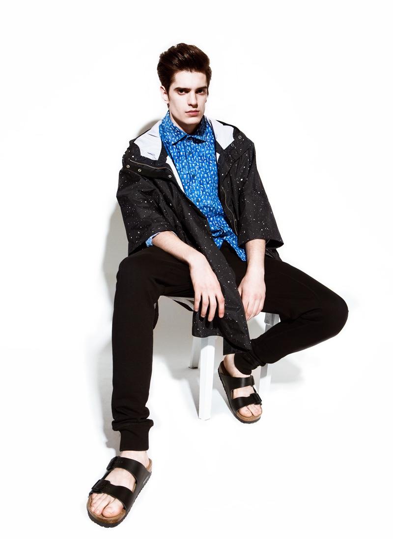 Daniel wears raincoat Supremebeing, shirt Desigual, trousers Redskins and sandals Birkenstock.