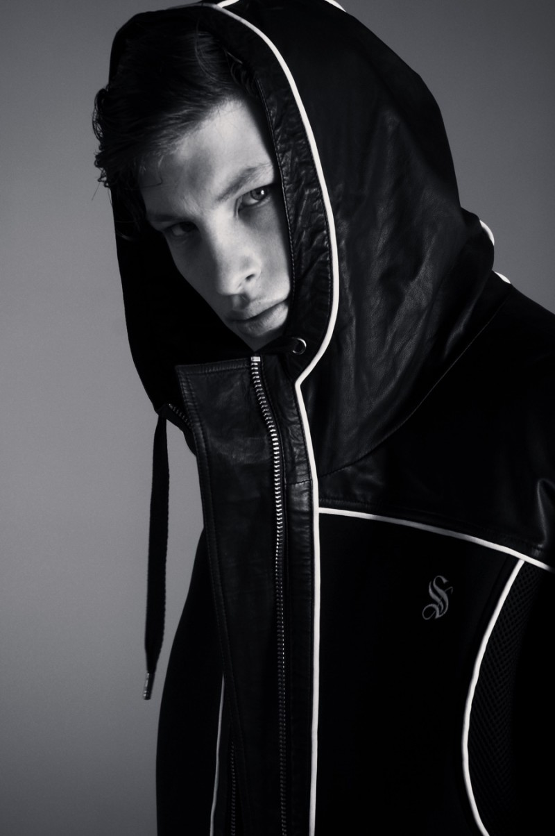 Jordan sports a hooded Skingraft jacket with detailed white piping.