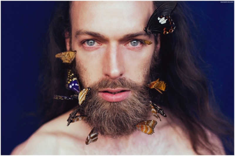 Will Lewis poses with butterflies