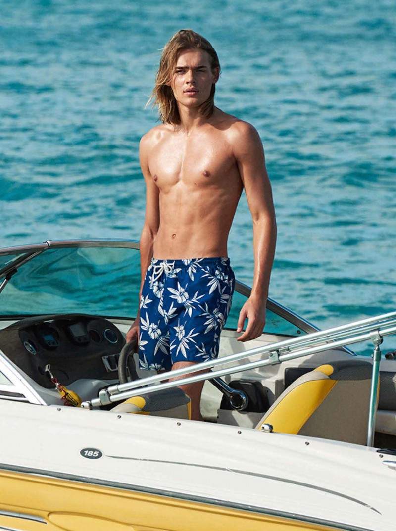 Ton Heukels wears a pair of tropical print swim shorts from H&M.