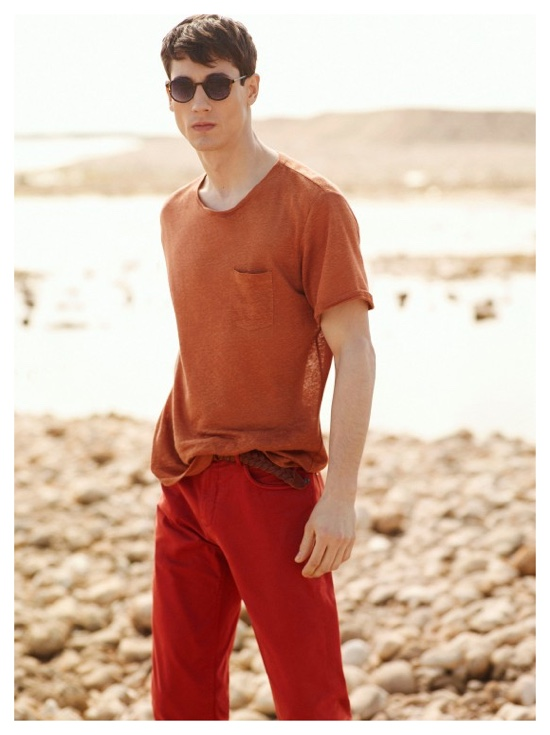 Nicolas is ready for summer in a colorful look that incorporates red and burnt orange.