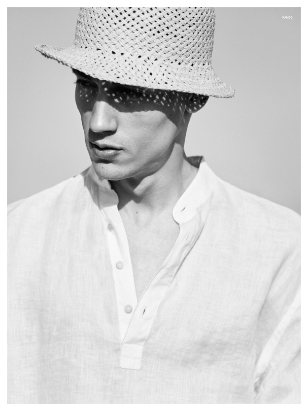 Nicolas blocks the sun with a chic straw hat.