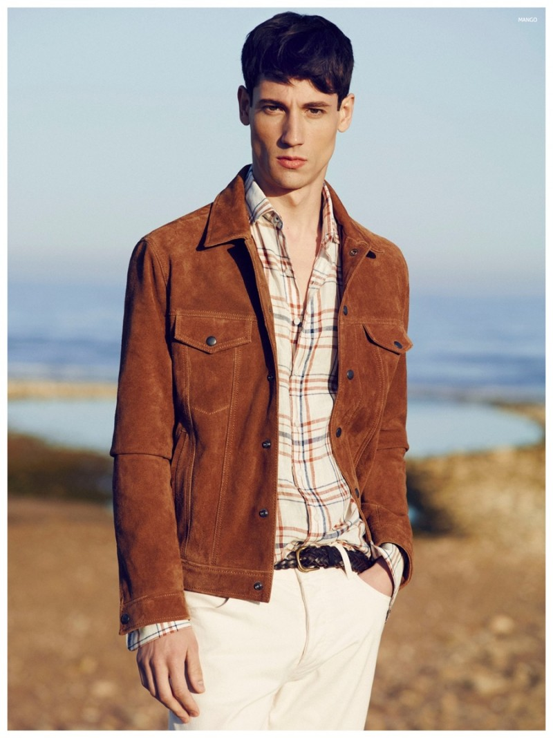 Nicolas ventures outdoors in a rich brown jacket.