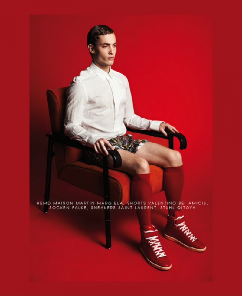 Simon taps into the shoot's red theme with knee-high socks and sneakers.