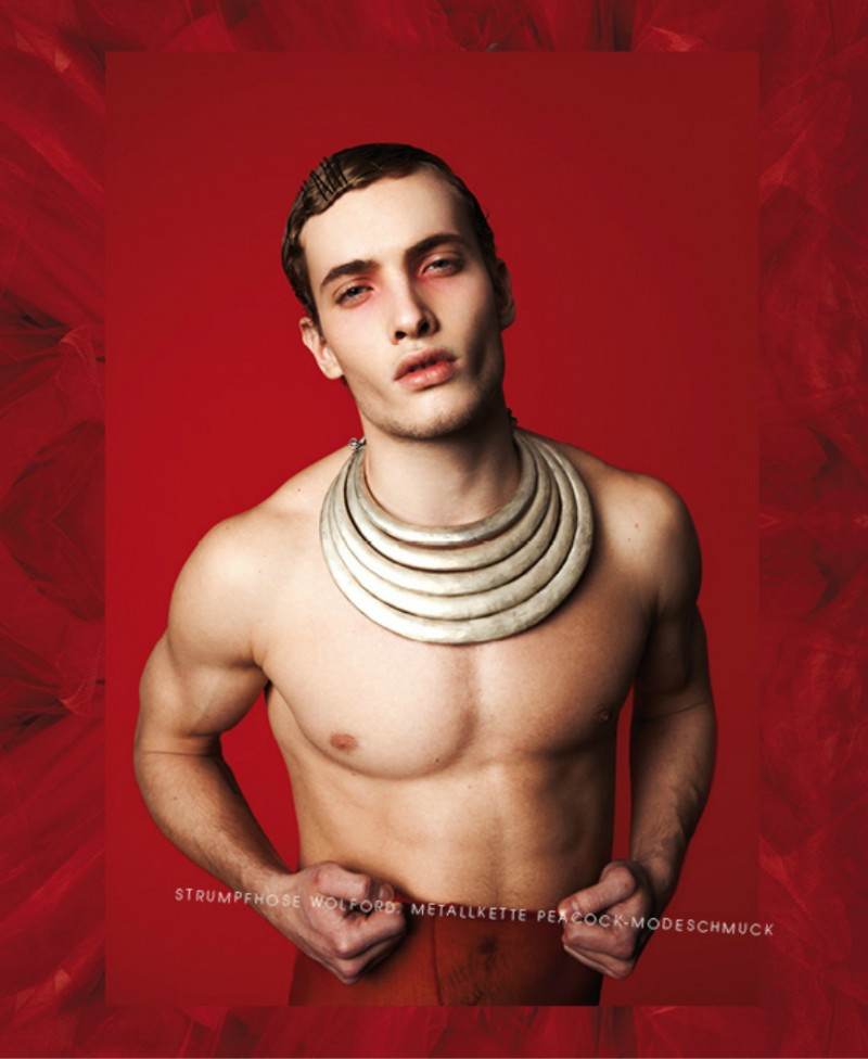 Simon embraces a bold look with a tribal inspired necklace.