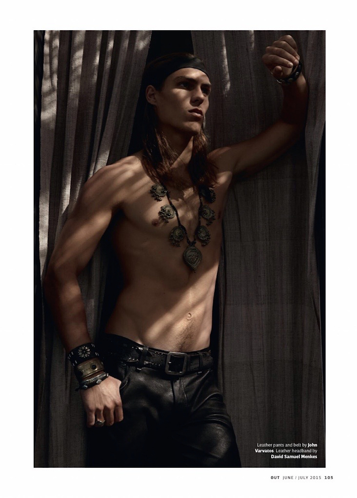 A shirtless Travis Smith poses in John Varvatos leather pants.