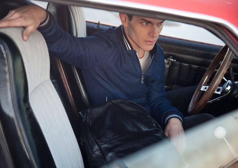 Vincent LaCrocq poses in his Mustang.