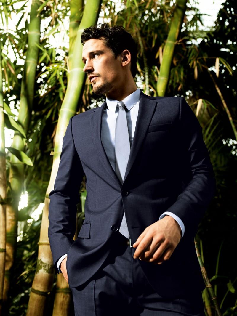 Sam suits up in a dapper suit.