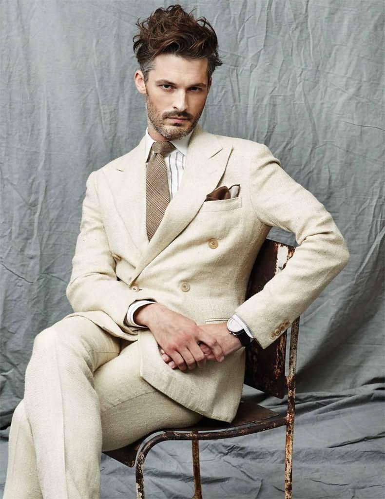 Ben is dapper in a linen suit from Ralph Lauren Purple Label.