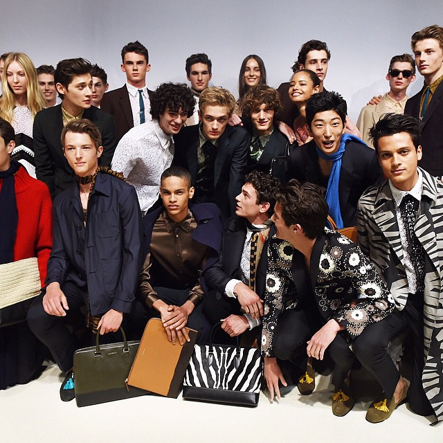 Models pose backstage at Burberry Prorsum's spring-summer 2016 show.
