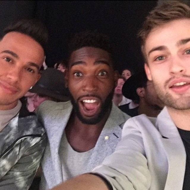 Lewis Hamilton, Tinie Tempah and Douglas Booth take a selfie front row at Topman Design's spring-summer 2016 show.