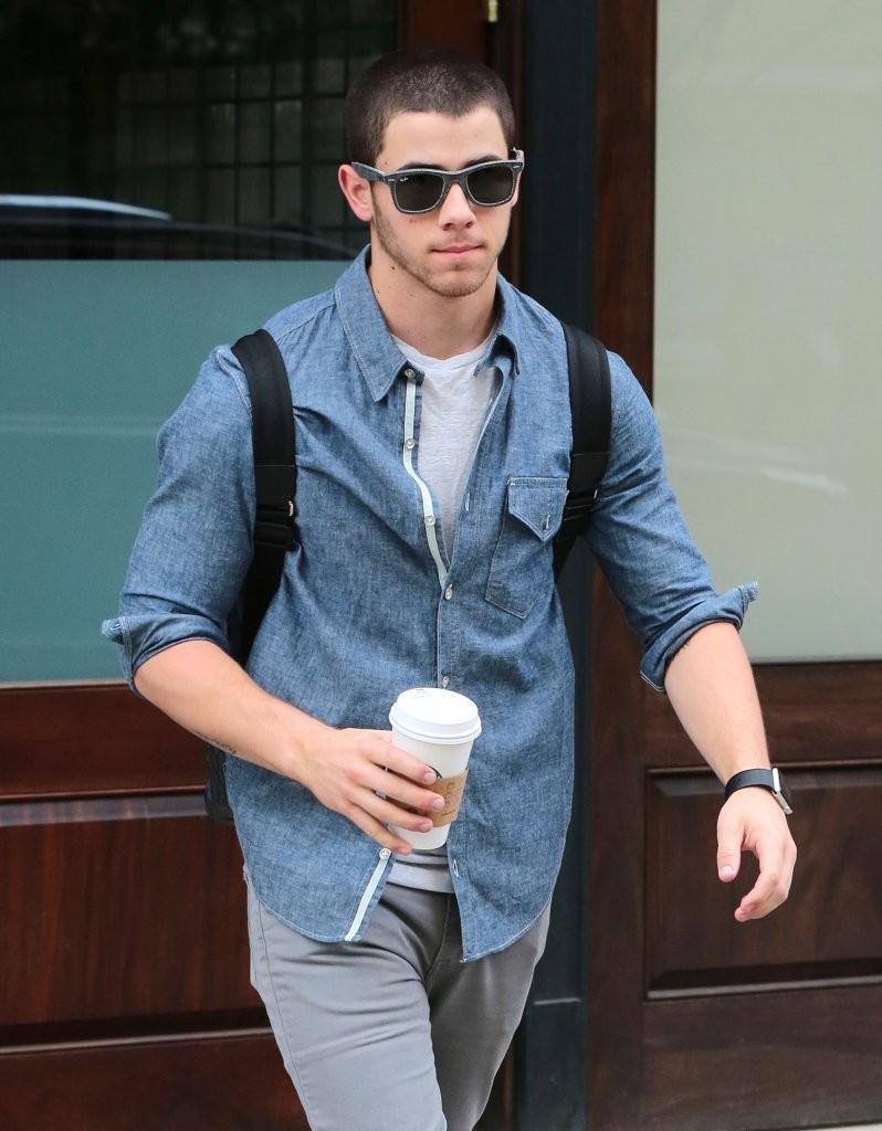 Nick Jonas Spotted in Ray-Ban Wayfarer Sunglasses + Rag & Bone Chambray Shirt
