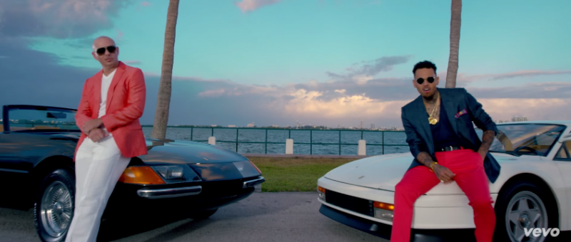 Pitbull and Chris Brown embrace Miami Vice inspired looks for their Fun music video.