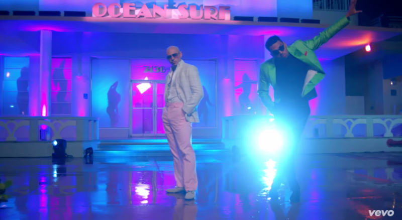 Capturing a modern take on Miami Vice style, music artists Pitbull and Chris Brown embrace bold color options in pink and lime green for their Fun music video.