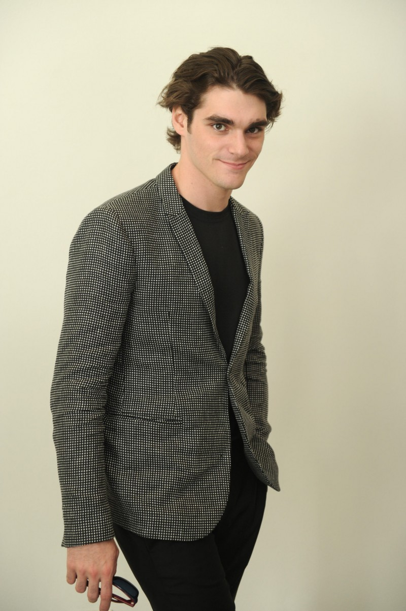 RJ Mitte poses for a photo at Emporio Armani's spring-summer 2016 show.