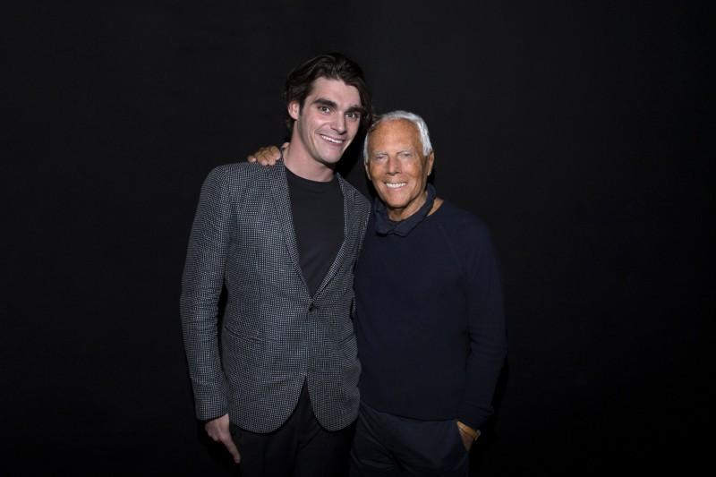 RJ Mitte poses for a photo with designer Giorgio Armani.