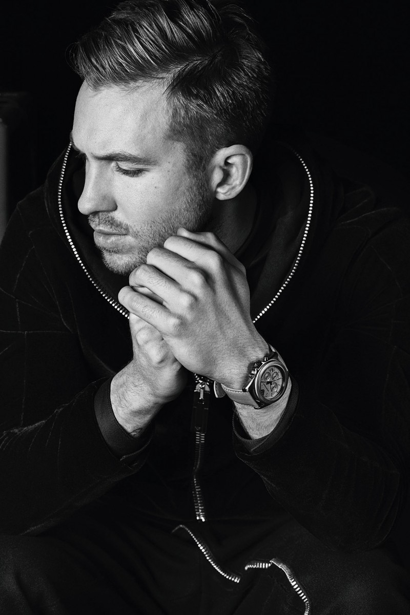 Posing for a close-up, Calvin Harris shows off one of Emporio Armani's timepieces for its fall-winter 2015 campaign.