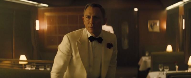 James Bond (Daniel Craig) is dressed to kill in a white tuxedo.