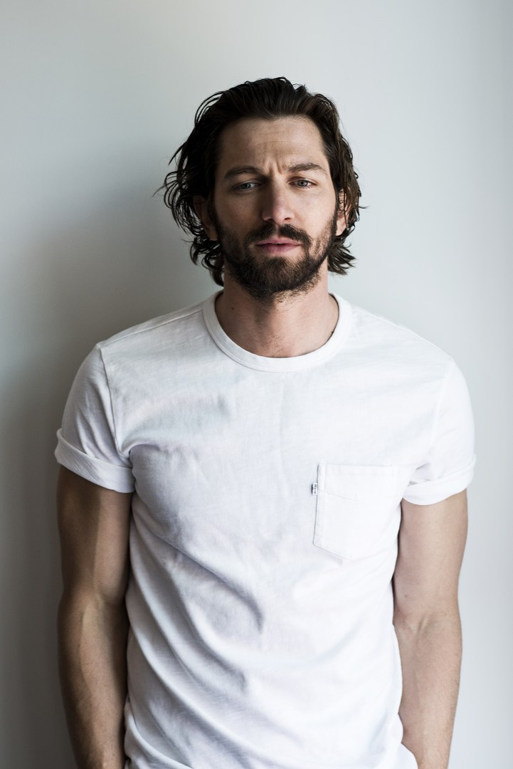 Michiel Huisman Dons Chic Fashions for Man of the World Cover Shoot