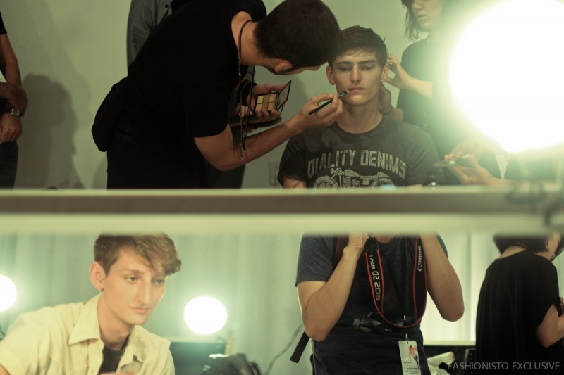 Models getting their makeup done for Perry Ellis' spring-summer 2016 menswear show.
