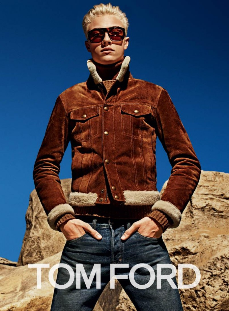 Lucky Blue Smith models a rich brown suede and shearling jacket with denim jeans for Tom Ford's fall-winter 2015 advertising campaign.