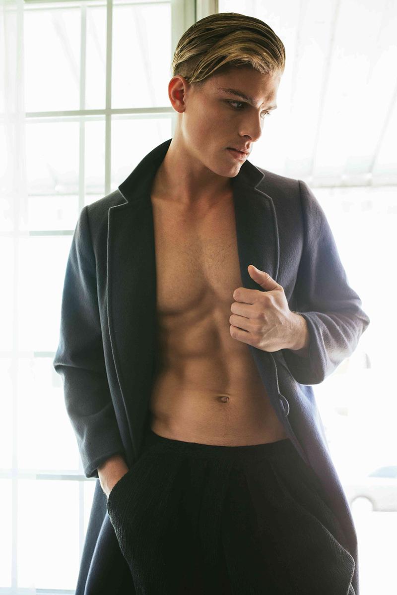 Austin wears coat Atelier Donato and pants H&M.