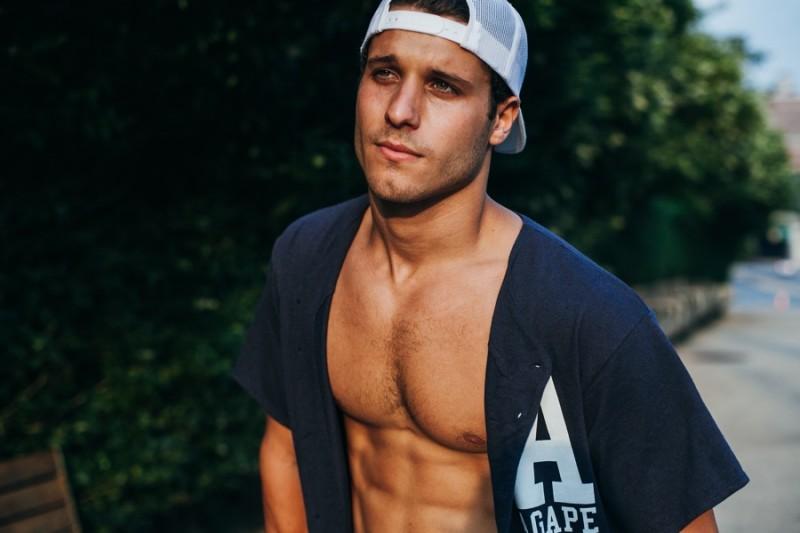 Cody wears shirt AGAPE Attire and cap his own.