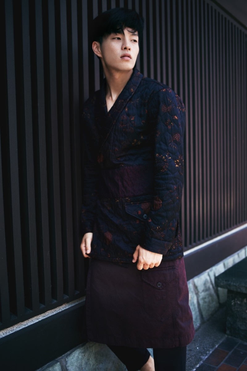 Satoshi wears trousers AllSaints, wrap-front jacket and kilt Dries Van Noten.