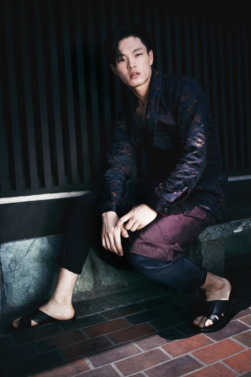Satoshi wears trousers AllSaints, sandals Saks Fifth Avenue Collection, wrap-front jacket and kilt Dries Van Noten.