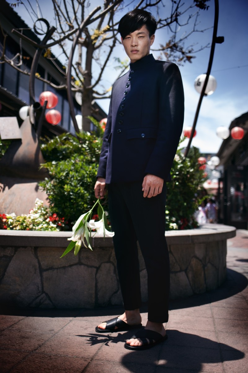 Satoshi wears reversible jacket Dries Van Noten, trousers AllSaints and sandals Saks Fifth Avenue Collection.