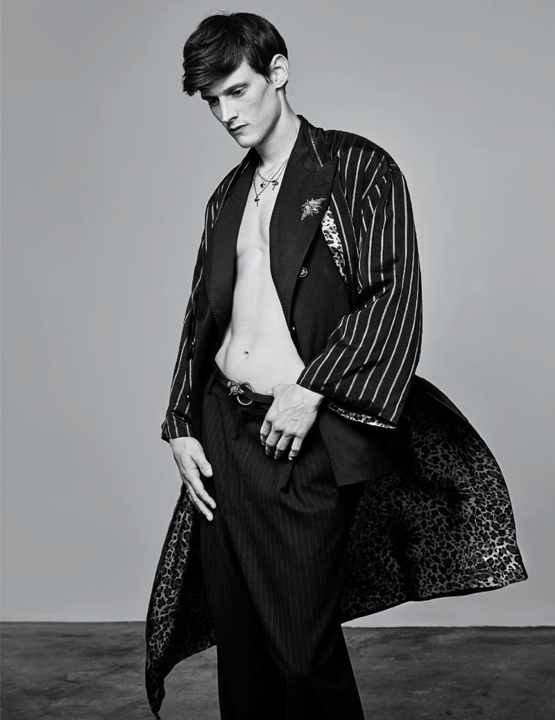 Adam Butcher rocks a coat from Dries Van Noten's latest collection.