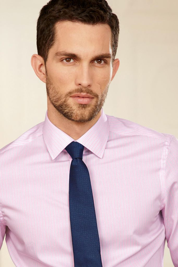 Model Tobias Sorensen sports smart shirt and tie combinations for Next.