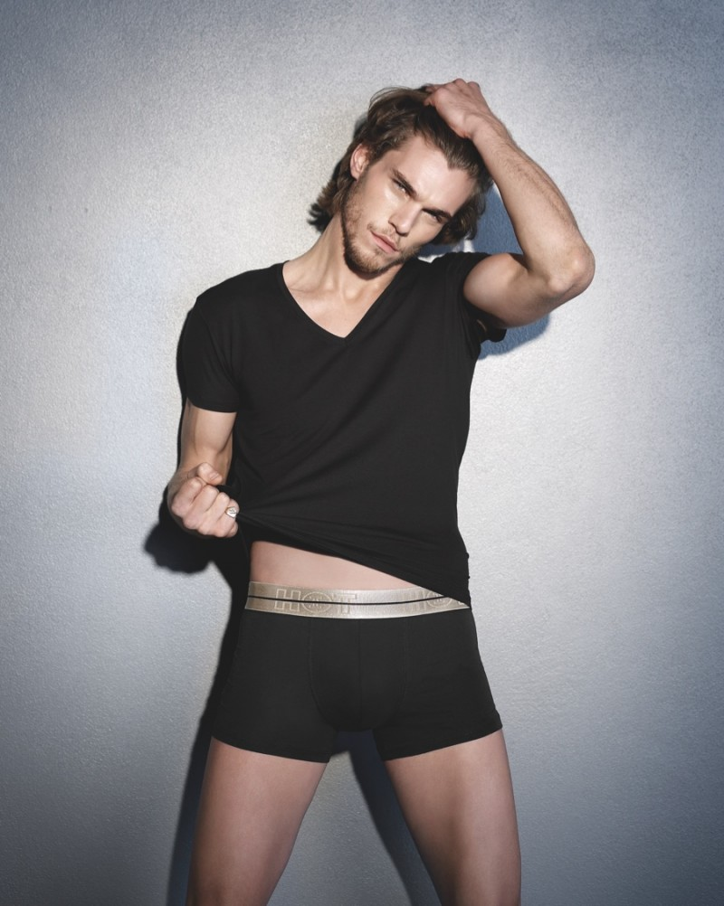 Pete Bolton poses for a relaxed images in an essential v-neck with a pair of black HOT Impetus briefs.