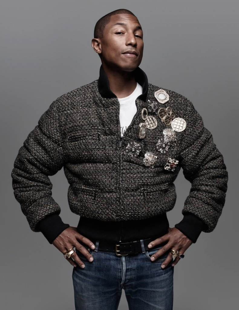 Pharrell Williams pours on the embellishments, donning a bomber jacket with pins and brooches.