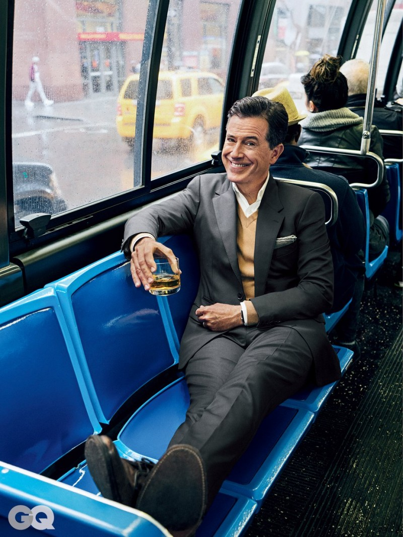 Stephen Colbert enjoys a drink as he rides the bus.