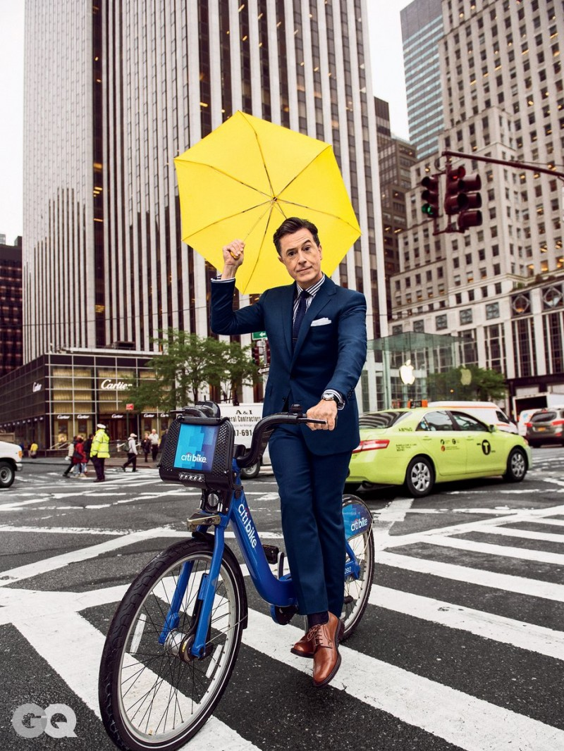 Stephen Colbert cleans up in a navy suit as he tackles New York City on a Citi bike.