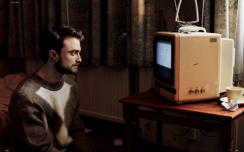Daniel Radcliffe watches the tube in a Bally sweater.