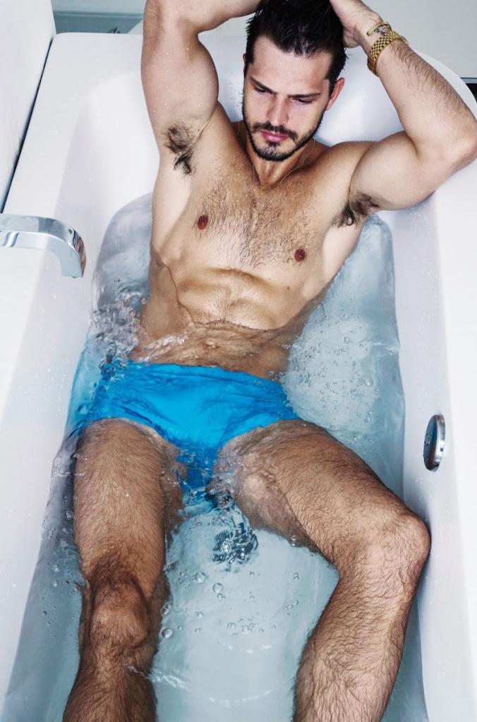 Diego wears swim shorts BOSS by Hugo Boss.
