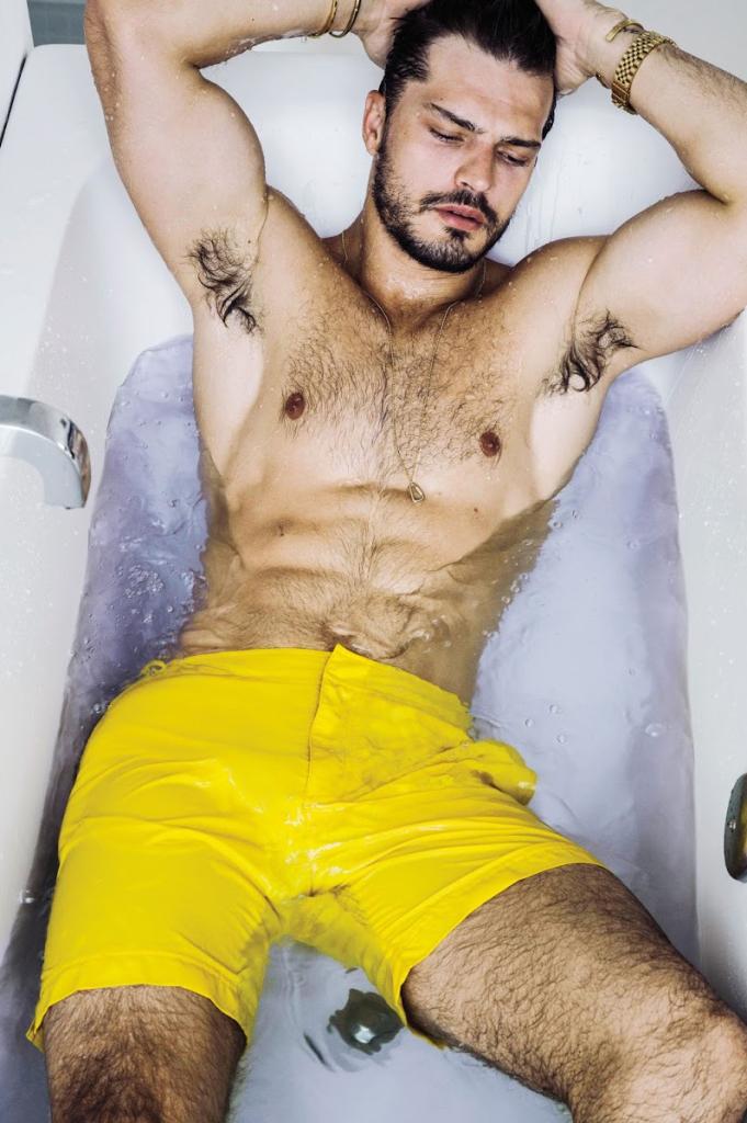 Diego wears swim shorts Orlebar Brown.