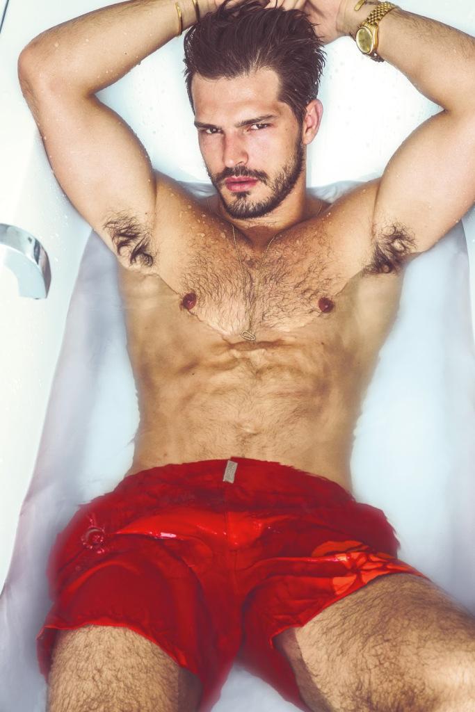 Diego wears swim shorts Vilebrequin.