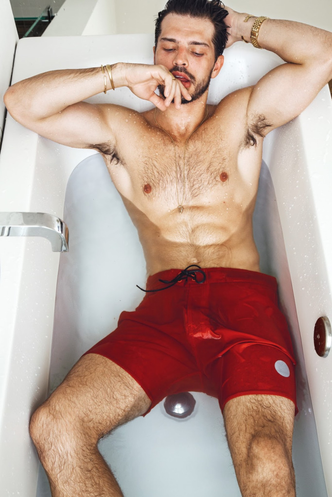 Diego wears swim shorts Saturday Surf NYC.