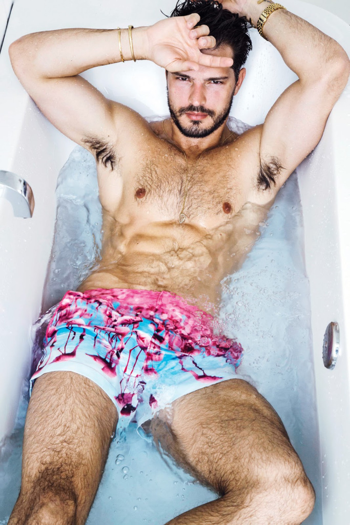 Diego wears swim shorts Original Penguin.