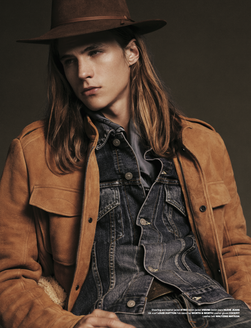 Malcolm Lindberg sports a western-style hat with denim and a brown suede jacket.