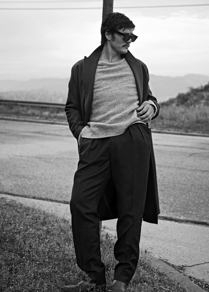 Pedro Pascal plays it cool as he poses in a long winter coat.