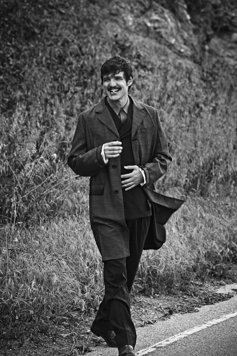 Pedro Pascal is all smiles as he heads outdoors for a black & white photo shoot.